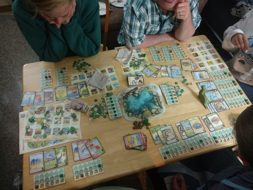 Players set up their species around the watering hole, and contemplate their next moves.