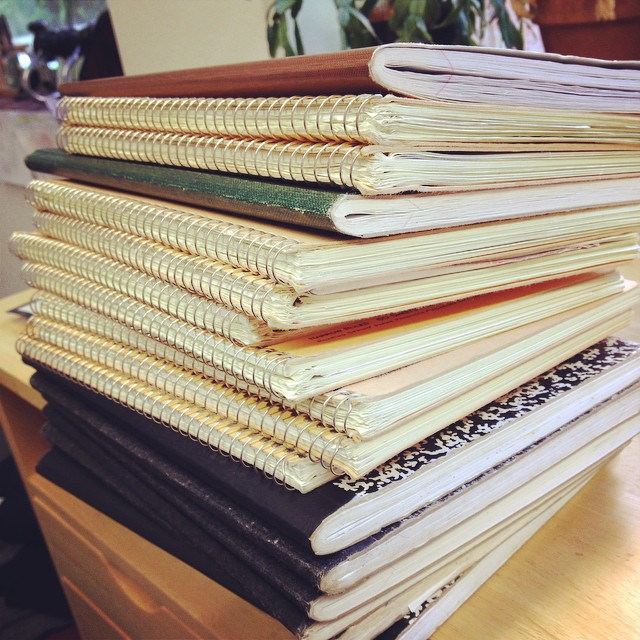 stack of research notebooks