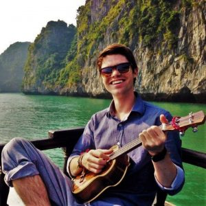 Matt having a grand time play his ukulele in Halong Bay, Vietnam