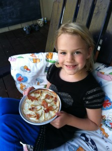Nora and her prosciutto-pear pizza, crust made from a Mission Carb Balance tortilla.