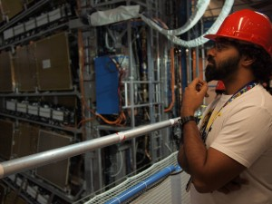 Sahal scrutinizing the ATLAS experiment at CERN.