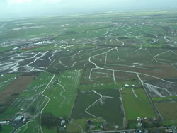 Aerial view of network of agricultural drainage ditches and stream channels during the flood season