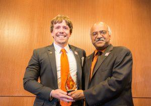 Scott Clark receiving the COS Young Alumni Award