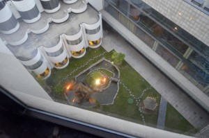 Looking down at courtyard from hotel room on 13th floor.