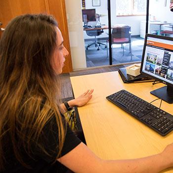 Allison Starkenburg working at a computer