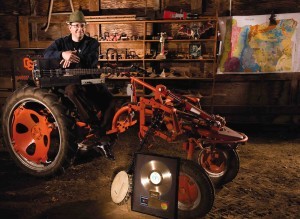 James Cassidy is surrounded by tools of the trade. The gold record, in front of the tractor, commemorates the sale of the first 500,000 copies of Information Society's first record. (Photo: Dennis Wolverton)