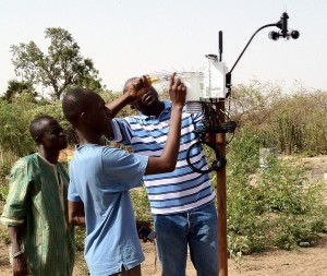 Workers install a TAHMO weather station in Kenya. (Photo courtesy of Zachary Dunn)