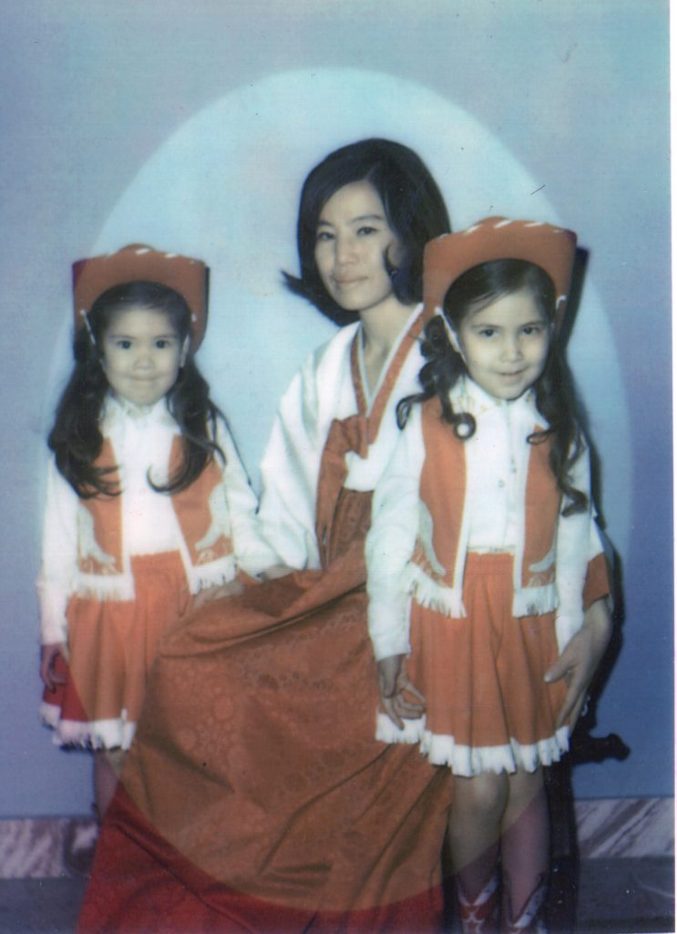In this portrait taken about 1974, western outfits worn by Patti Duncan and her sister contract with their mom's traditional Korean hanbok. (Photo courtesy of Patti Duncan)