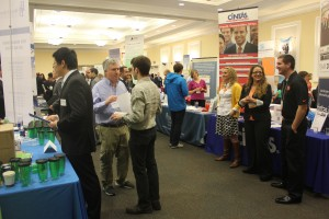 Image of students talking with recruiters at various booths during Career Fair