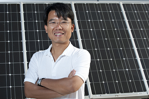 Chih-hung Chang standing in front of an array of photovoltaic panels.