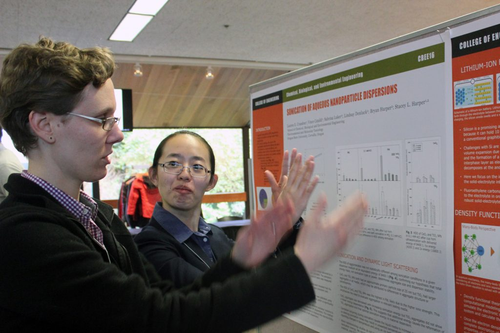 Graduate students Lynza Sprowl, left, and Qin Pin discuss their posters at the 2018 Graduate Research Showcase.