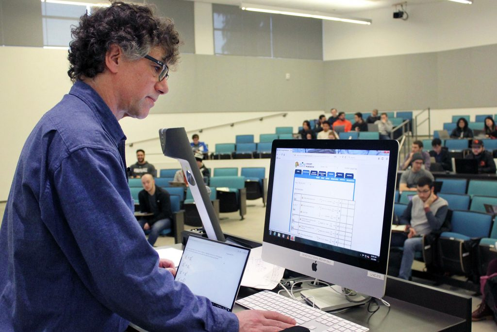 Photo of Milo Koretsky in classroom, using Concept Warehouse computer software.