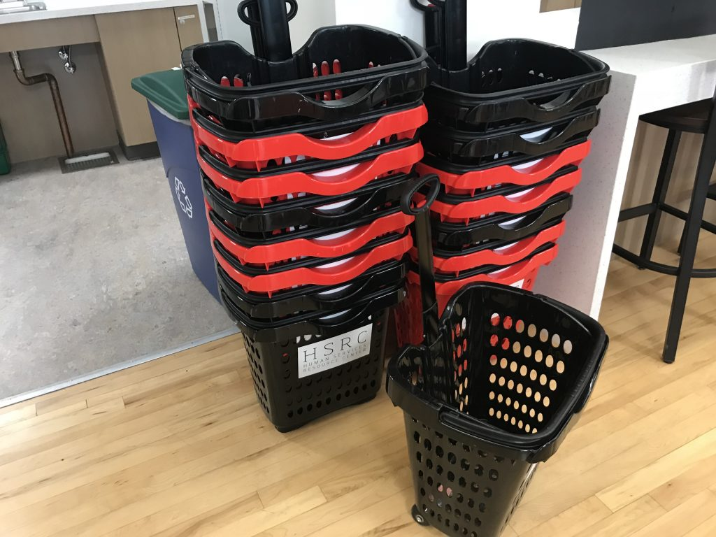 Stacked of red and black shopping baskets