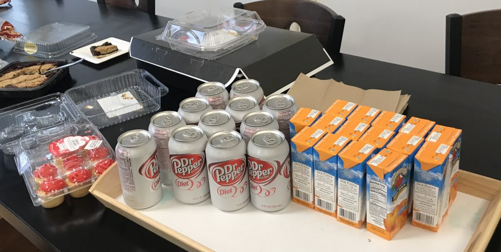 Diet Dr. Pepper and juice boxes are on a table.
