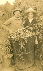 Couple of children with hops baskets