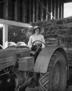 Elsie Hill on a tractor, 1944
