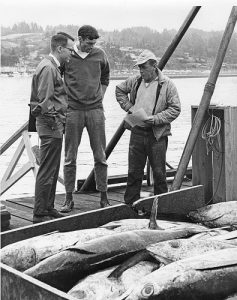 Dan Panshin and Bob Jacobson talk to an albacore tuna fisherman, 1965