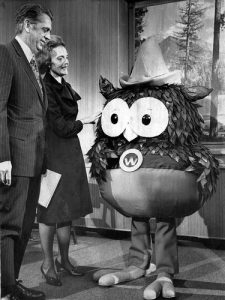 Mr. and Mrs. Clifford Hardin meet Woodsy Owl. Woosy is the newest environmental symbol of the United States.