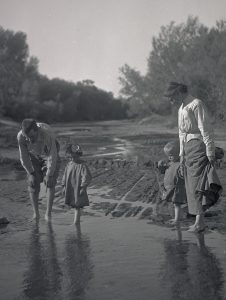 William L, Irene, Phoebe Katherine, and William L. Jr. wading in the Santa Cruz River. Arizona, 1910. OHS Research Library, Org. Lot 369, Finley A0065.