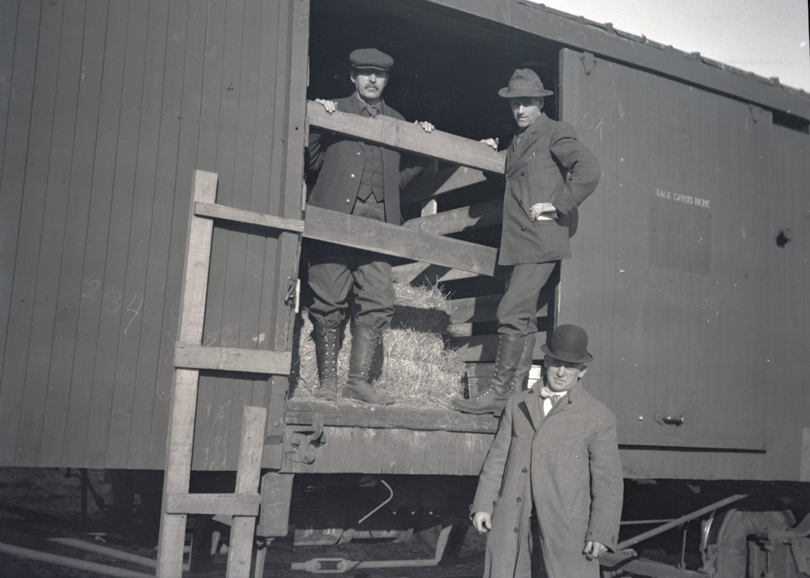 Three men standing at the door of a boxcar used to transport elk from Saint Anthony, Idaho to Joseph, Oregon, 1912. OHS Research Library, Org. Lot 369, Finley B0408.