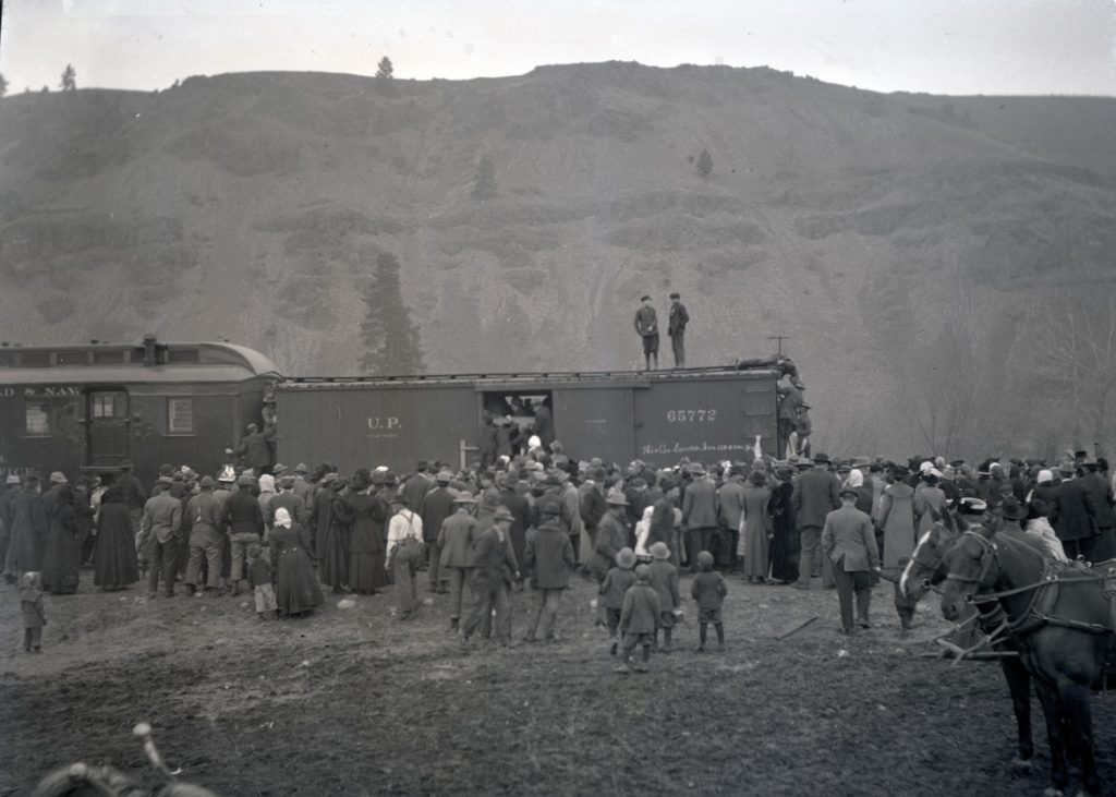 A large crowd gathered to view elk loaded in a boxcar on their trip from Saint Anthony, Idaho to Joseph, Oregon, 1912. OHS Research Library, Org. Lot 369, Finley B0433.