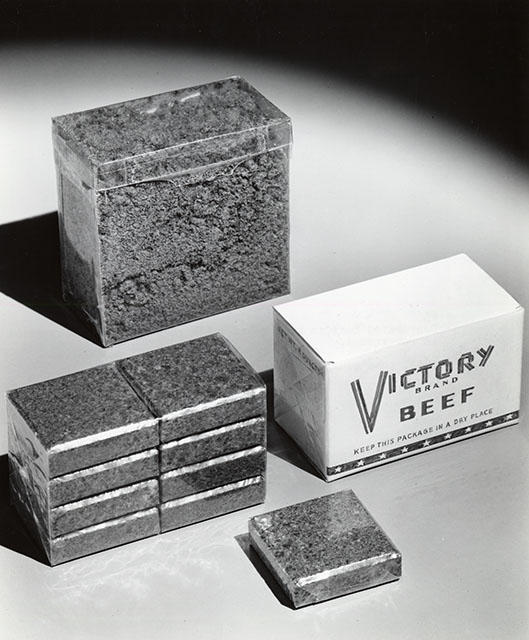 Background: 65% reduction when compressed. Foreground: small cube equals two generous servings, circa 1940. From the Food Science and Technology Department Photographs Collection.