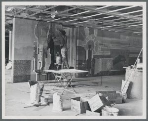Public art as a feature of building architecture is nowhere more apparent than the OSU Library, where a series of tile mosaic murals were installed during the building's construction. Art Professor Nelson Sandgren designed and created the murals, parts of which remain visible today. This section is on the third floor. (Harriet's Photograph Collection, 1962)