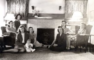 Women at the Home Management House (with practice baby), c. 1940