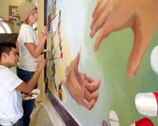 Students work on the mural in the College of Pharmacy