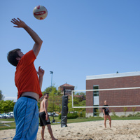 Students playing volleyball outside of Dixon