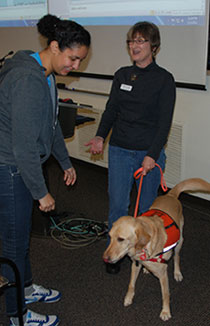 Student meets hearing dog, Cherelle