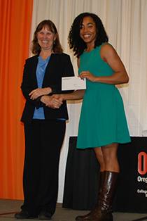 Gabby Wallace accepts the Otto and Helga Sprint scholarship from Dean Tornquist.