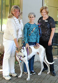 L to R: Hospital volunteer Jeanine Preston, client xxxxx with her dog Chopper, and Client Relations Advocate Tammy Barr.
