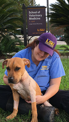 OSU alumna Clare Scully helps a victim of the Louisiana flooding.