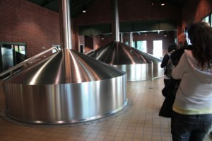 OSU MBA students tour the Widmer Brothers Brewery in Portland. Here they inspect brewery tanks.