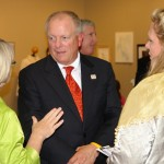 Nancy King (left) talks to MBA Graduation Celebration speaker Bob Mayes (center) following the ceremony.