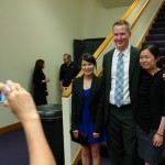 Grads get photos at the reception following the MBA Graduation Celebration.
