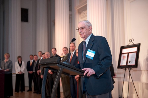 Former Oregon Governor Vic Atiyeh accepting an Excellence in Family Business Award for the Atiyeh Oriental Rugs family.
