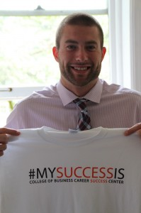 Charlie Gilmur holds up a My Success Is shirt