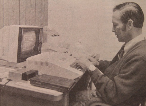 A professor works on the College of Business' new Apple II computer in 1980.