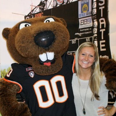 Finance alumna Sara Stillwell poses with Benny the Beaver