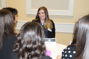 Claire Rose, an OSU grad working for Macy's, talks to students at the symposium.