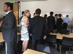 Presenter Katie Merrill talks with schoolmates and students from the UO at the breakfast portion of the meeting.
