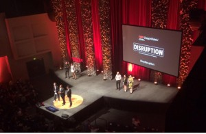 Organizers and speakers take the stage one final time at the event's close.