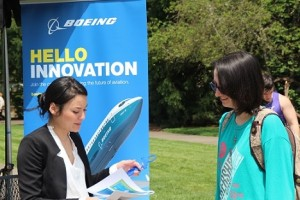 Sierra Makepeace of Boeing, left, talks with pre-graphic design student Hannah King at Boeing's booth in the MU quad.