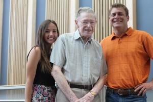 Scholarship recipients Brittany Soto and Charles White with retired management professor Jack Rettig, for whom the scholarship is named.