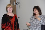 Dean Mitzi Montoya, right, lauds Shari Sands at the finance and accounting manager's retirement party.