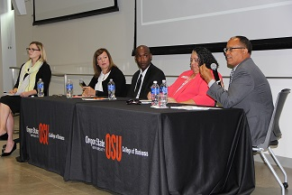 Panelist Tim Hall addresses the audience while moderator Audrey Iffert-Saleem, left, and panelists Monica Baez, Lawrence Houston III and Angela Batista listen.