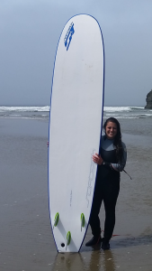 Me with a giant surfboard and a giant smile