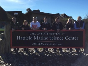 2014-2015 Officer Team poses behind the Hatfield Marine Science Center sign during the Winter Officer Retreat.